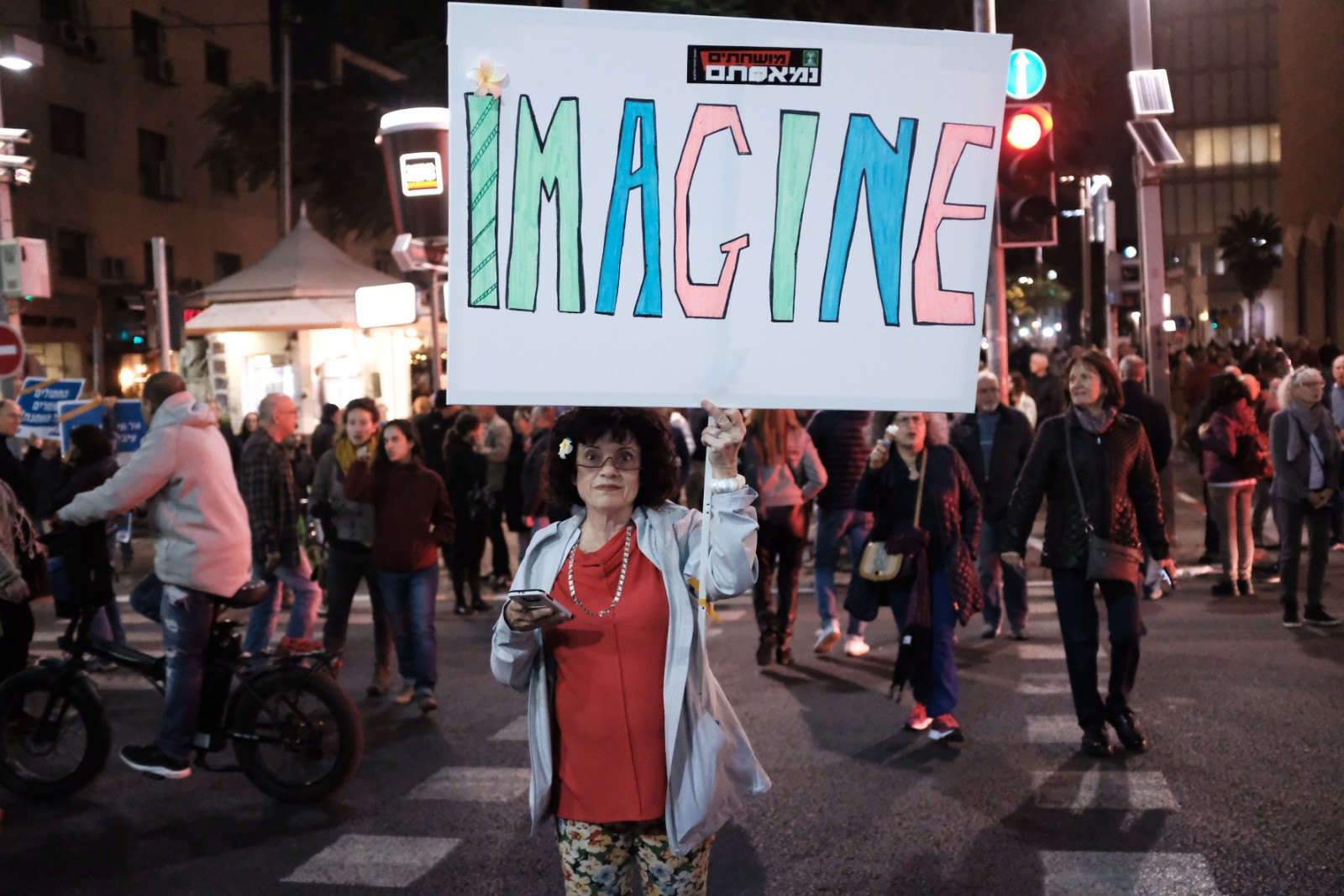 'Our Image of the Week is Israelis attending a rally in Tel Aviv against what they claim is the corruption of the government, 9 December 2017. Photo by Tomer Neuberg.' from the web at 'http://fathomjournal.org/wp-content/uploads/2017/12/image-of-week-11-dec.jpg'